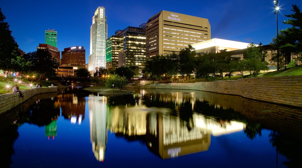 Omaha featuring night scenes, a high-rise building and a city