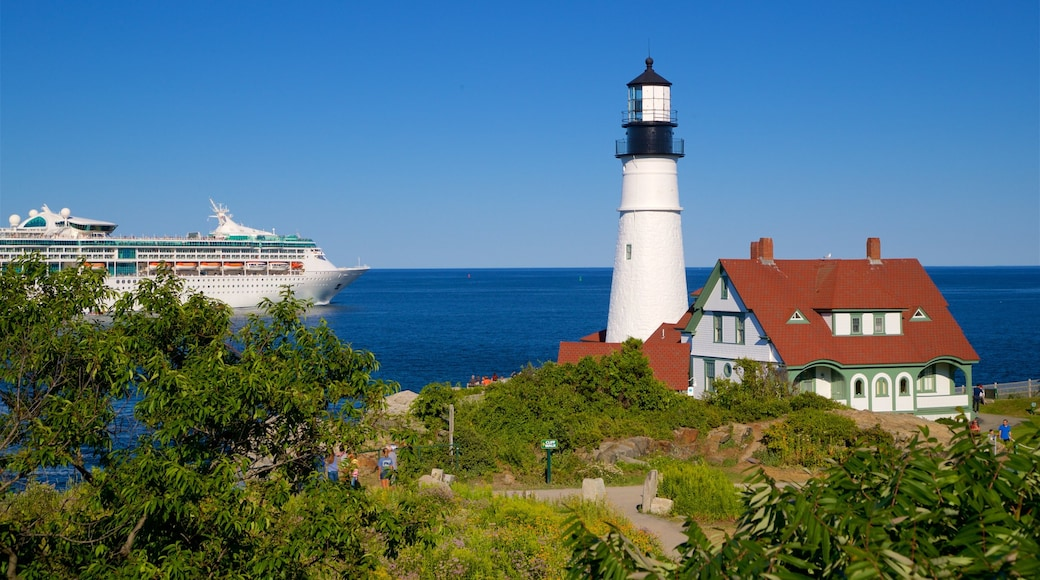 Portland Head Light featuring a lighthouse, general coastal views and cruising