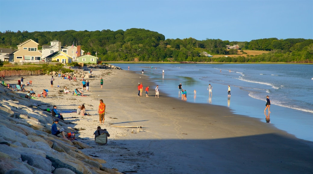 Higgins Beach showing general coastal views and a beach as well as a small group of people