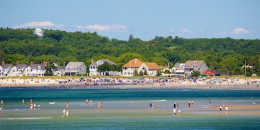 Scarborough featuring a coastal town and general coastal views as well as a large group of people