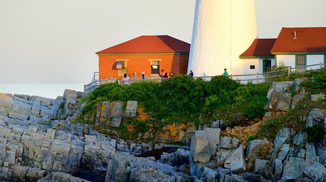 Portland Head Light showing general coastal views, rugged coastline and a sunset