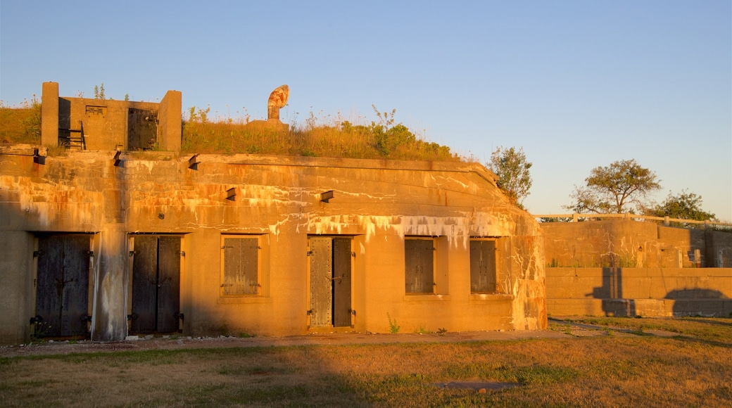 Fort Preble featuring heritage architecture and a sunset