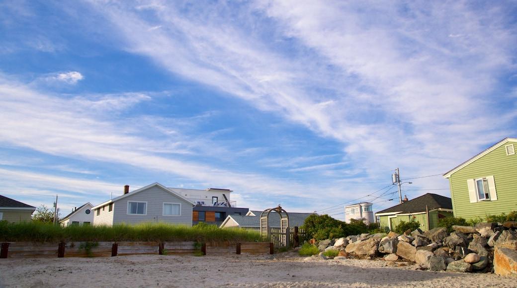 Higgins Beach featuring a sandy beach and a coastal town