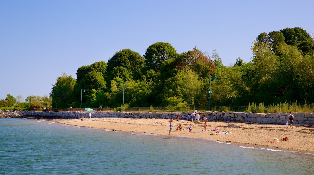 East End Beach which includes general coastal views and a beach as well as a small group of people