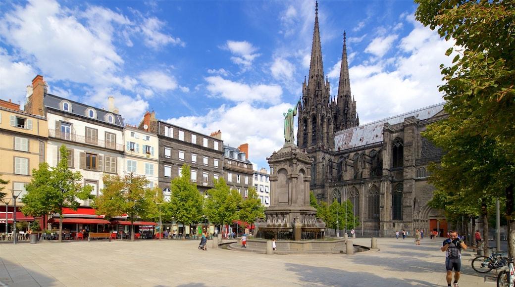 Cathédrale de Clermont-Ferrand qui includes statue ou sculpture, ville et fontaine