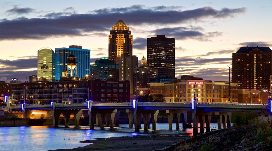 Des Moines showing a bridge, a skyscraper and a sunset