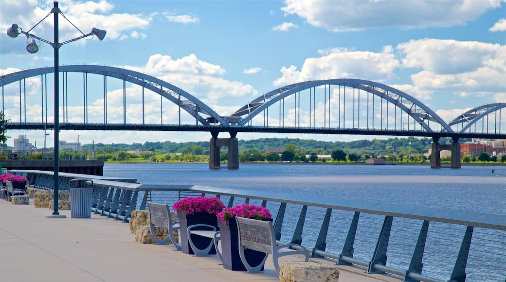 Davenport featuring a bridge, flowers and a river or creek