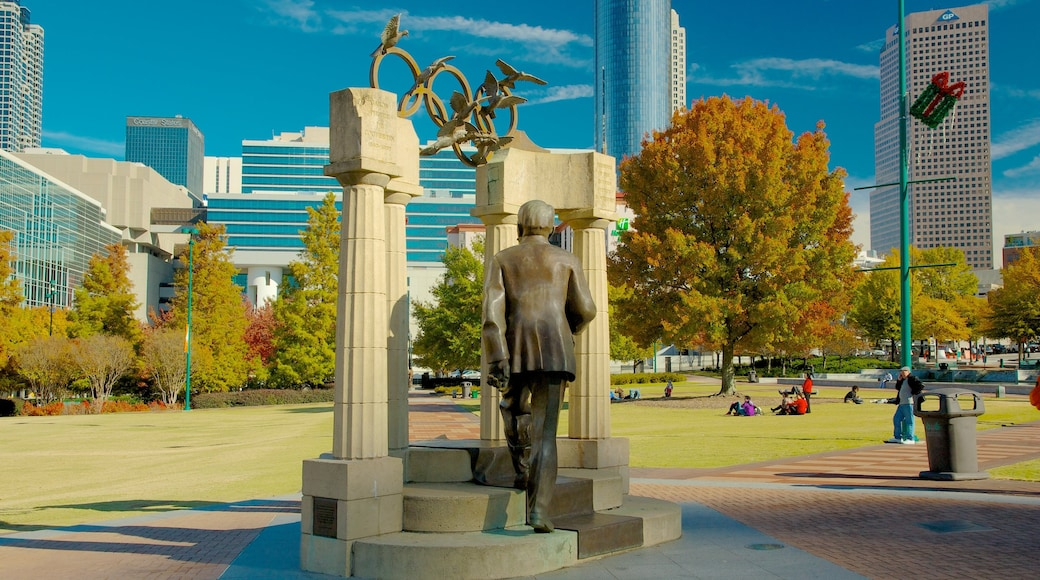 Centennial Olympic Park showing a statue or sculpture, a city and a park