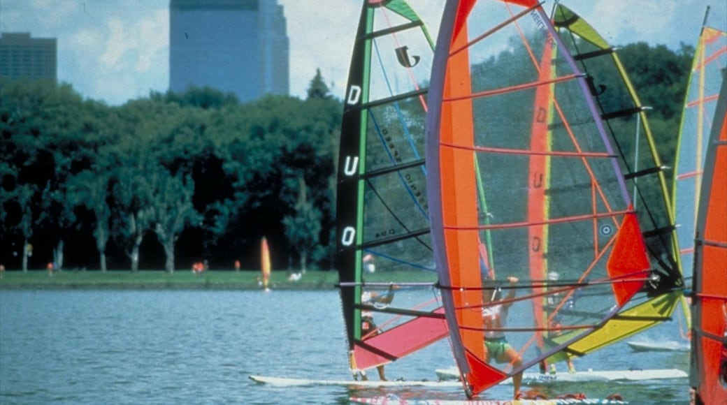 Lake Calhoun showing windsurfing, landscape views and a sporting event
