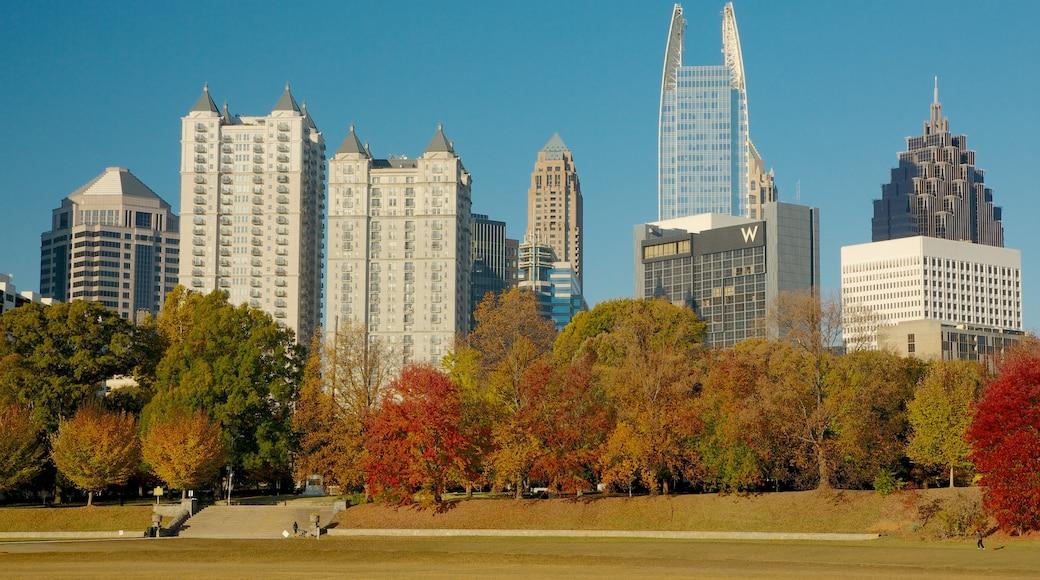 Piedmont Park showing autumn colours, a park and a skyscraper