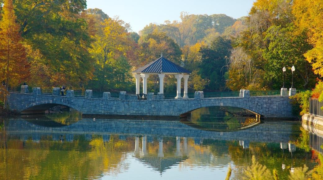Piedmont Park which includes a bridge, a park and landscape views