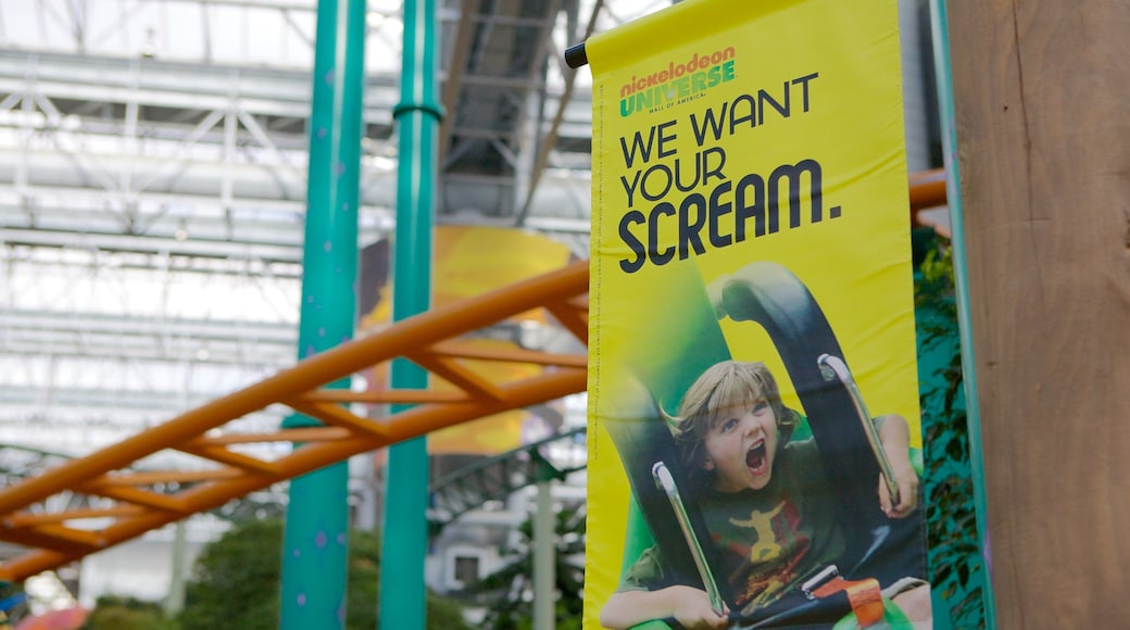 Nickelodeon Universe featuring signage, rides and interior views
