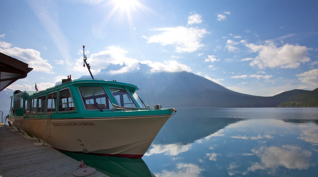 Lake Minnewanka which includes boating, a lake or waterhole and mountains