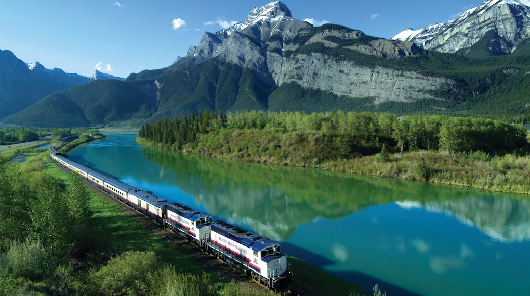Banff National Park which includes railway items, a lake or waterhole and mountains