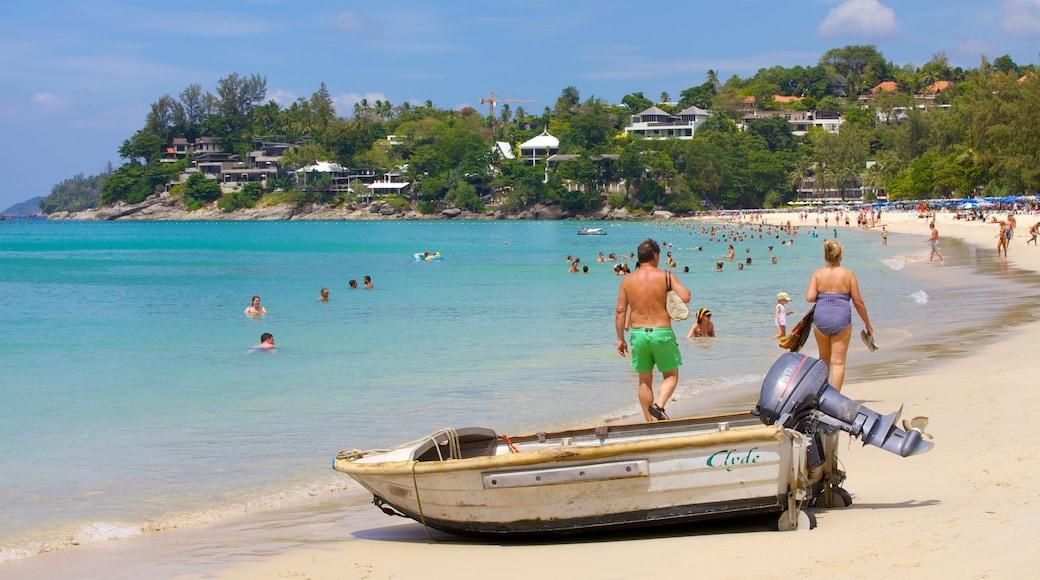Kata Noi Beach featuring swimming, a coastal town and tropical scenes