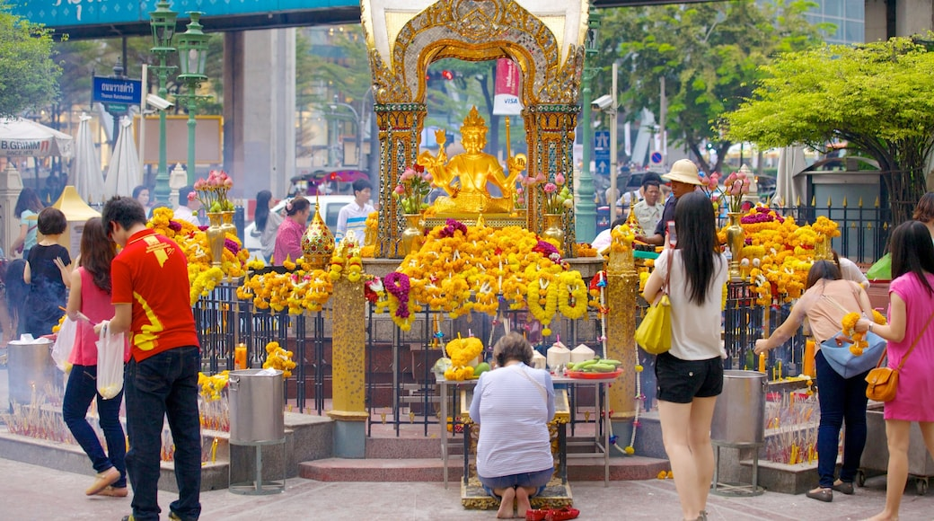 Erawan Shrine which includes religious aspects, a city and street scenes