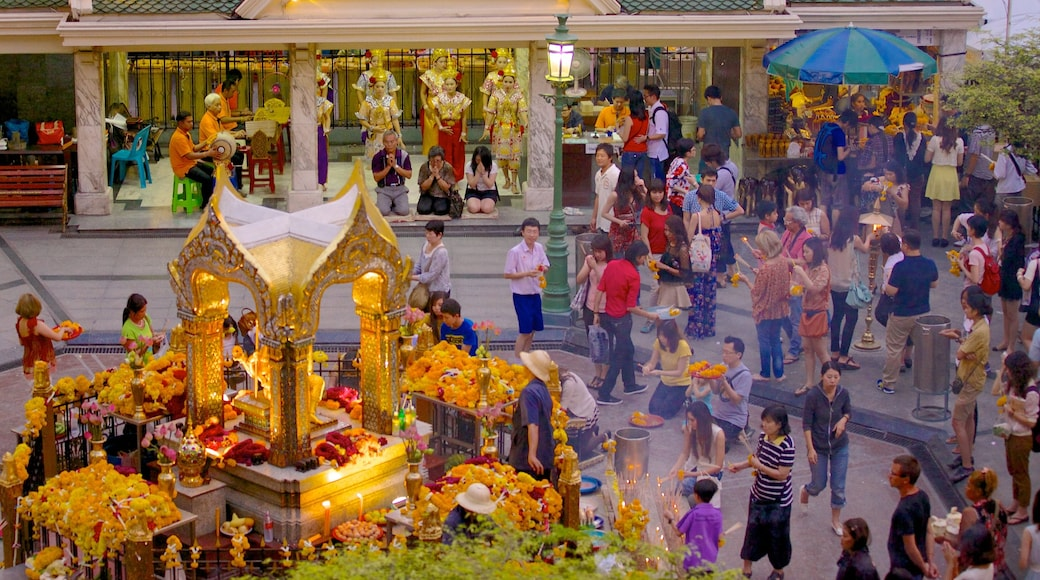 Erawan Shrine featuring religious aspects and street scenes as well as a large group of people