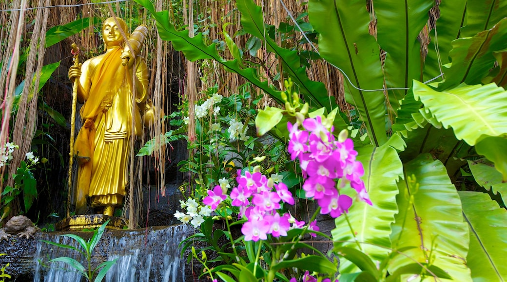 Wat Saket which includes flowers and a statue or sculpture