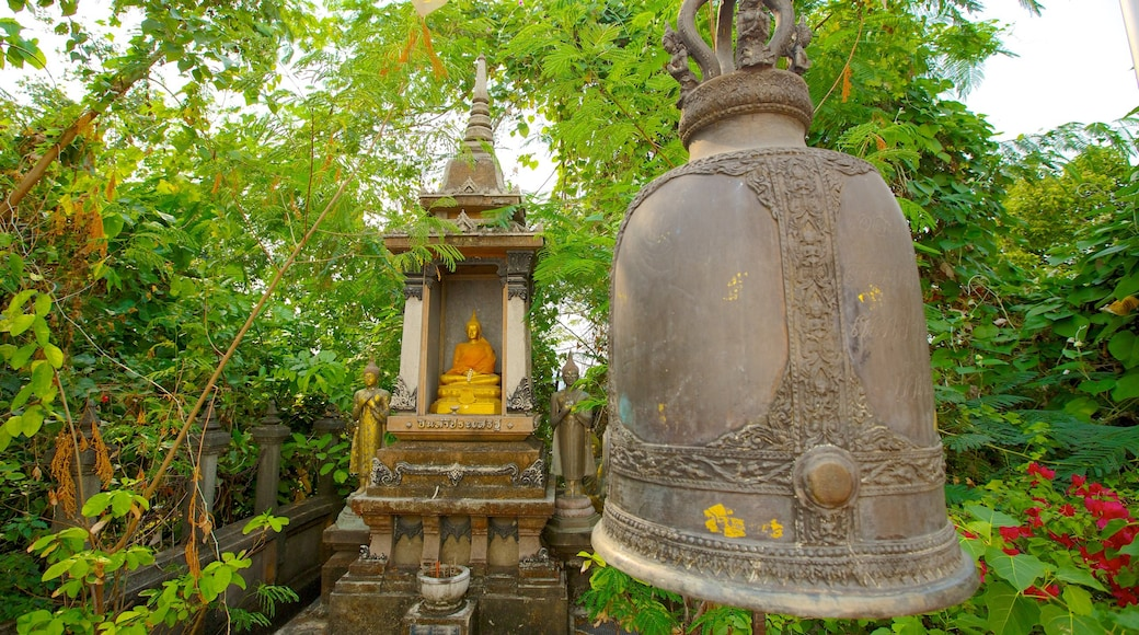 Wat Saket which includes a temple or place of worship, religious elements and a garden