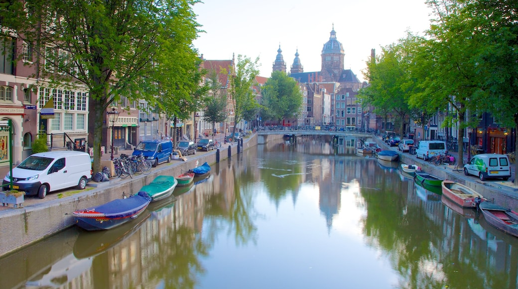 Red Light District which includes street scenes, a lake or waterhole and general coastal views