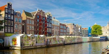 Blumenmarkt welches beinhaltet Fluss oder Bach, Stadt und Märkte