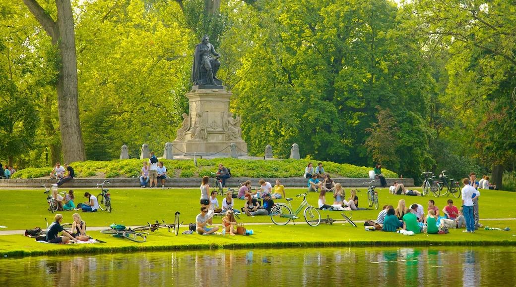 Amsterdam welches beinhaltet Picknicken, Statue oder Skulptur und Monument