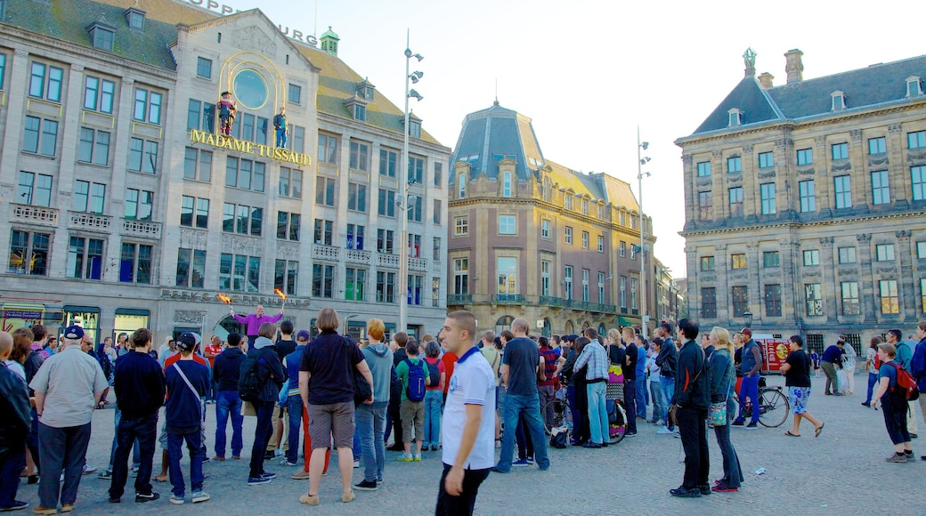Dam Square which includes heritage architecture, street scenes and a city