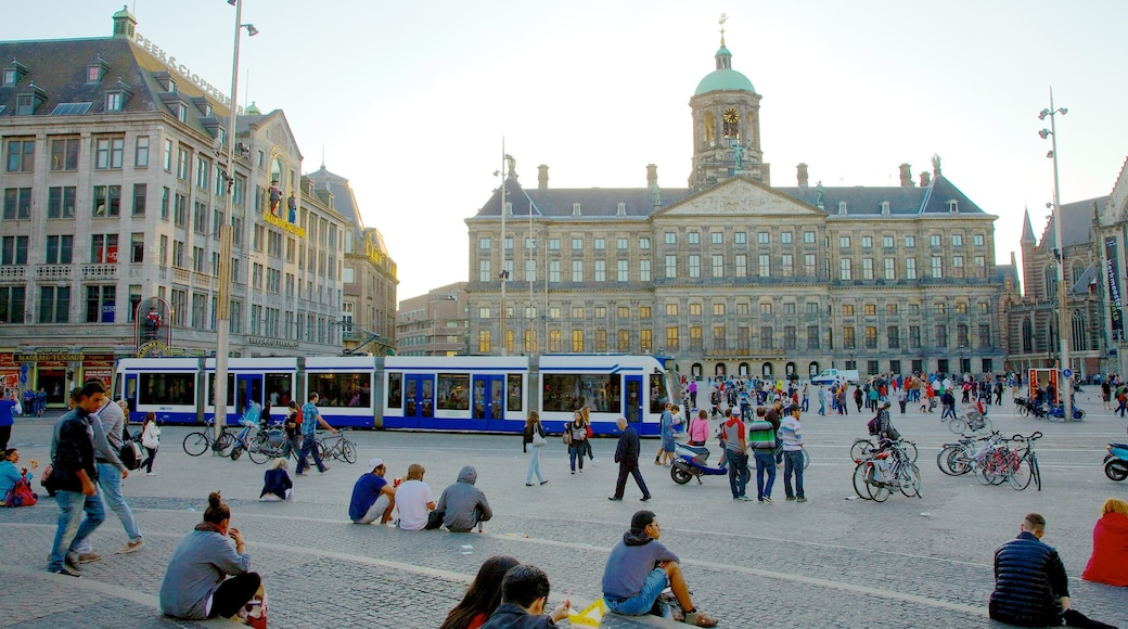 Dam Square which includes road cycling, a square or plaza and a city