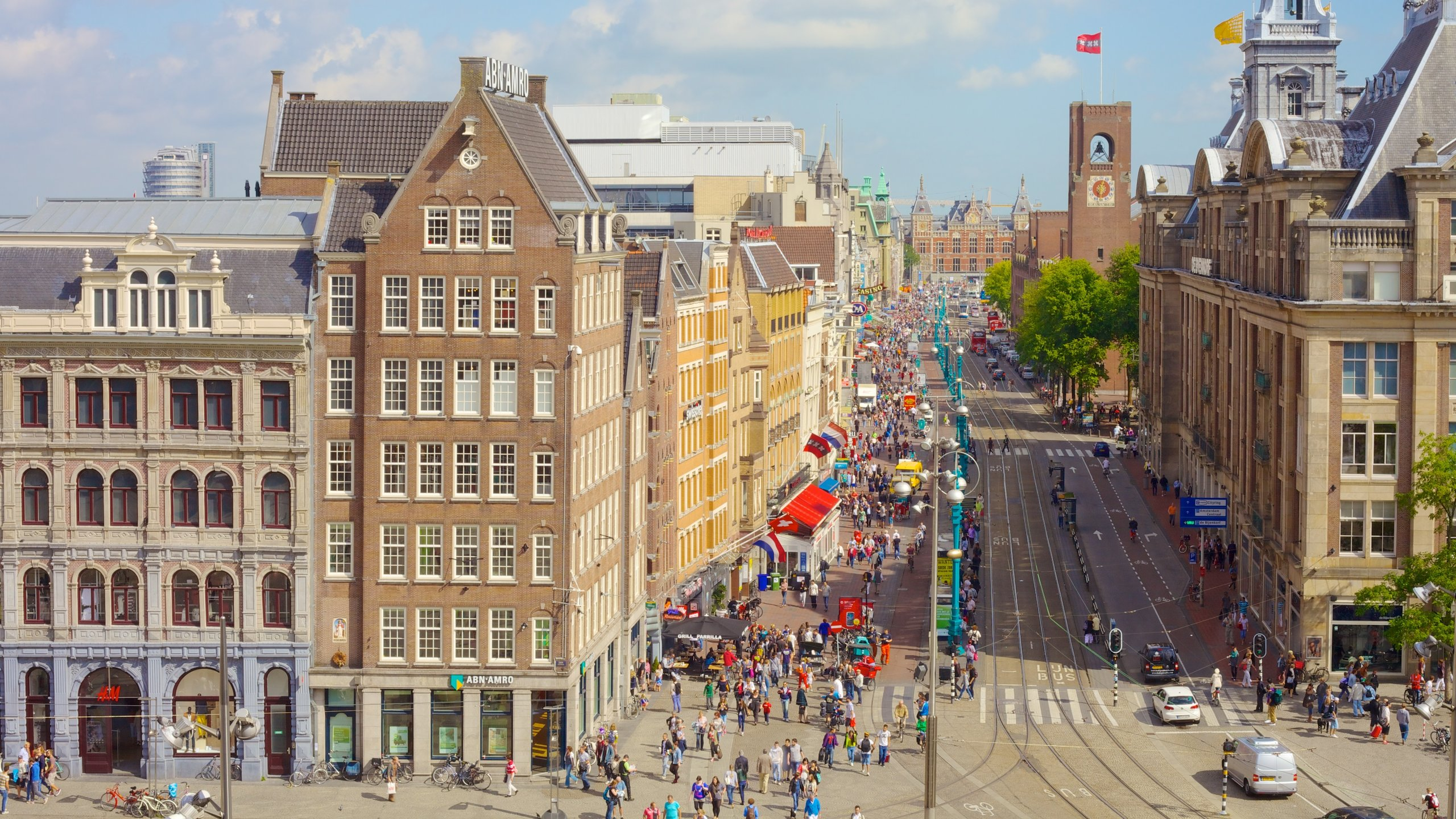 Visit Amsterdam's lively central square, a venue that's seen both protests and celebrations.