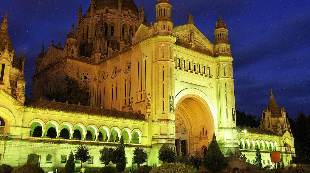 Lisieux which includes religious elements, night scenes and a church or cathedral
