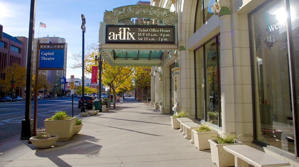 Capitol Theater mostrando una ciudad, escenas cotidianas y escenas de teatro