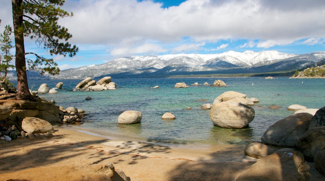 Sand Harbor which includes a sandy beach, landscape views and mountains