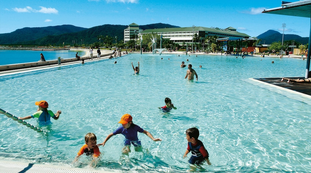 Cairns Esplanade which includes a luxury hotel or resort, a pool and swimming