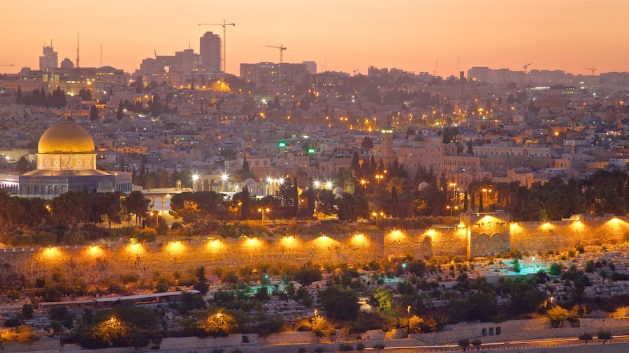 Mount of Olives which includes landscape views, a city and a sunset
