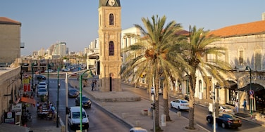 Jaffa Clock Tower showing a city, heritage architecture and a sunset