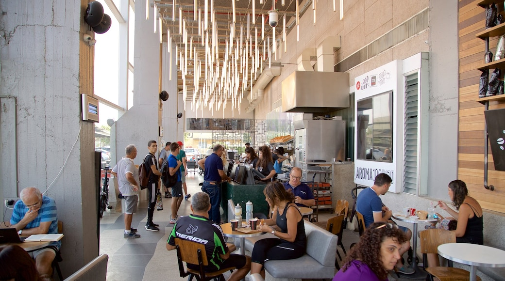 Old Tel Aviv Port showing cafe lifestyle and interior views as well as a small group of people