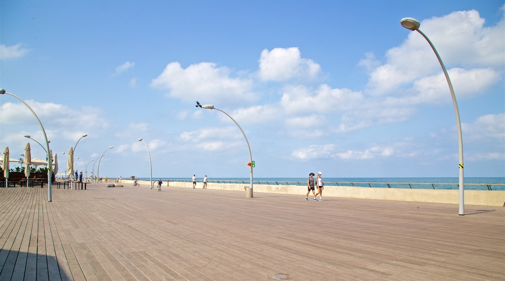 Old Tel Aviv Port featuring hiking or walking and general coastal views as well as a couple