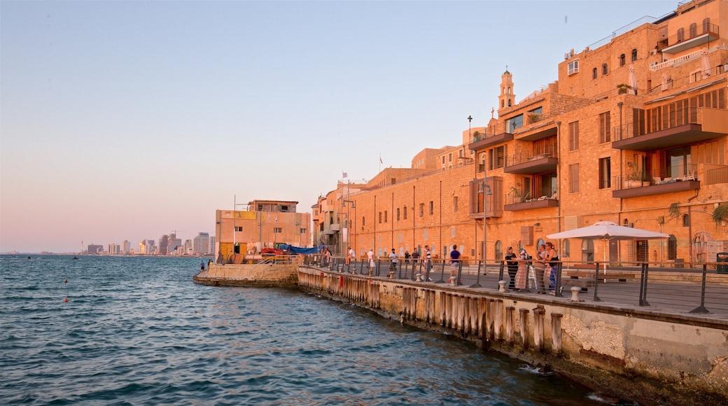 Jaffa Port showing a coastal town, general coastal views and a sunset