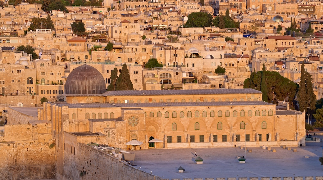 Al-Aqsa Mosque showing heritage elements, a sunset and a city