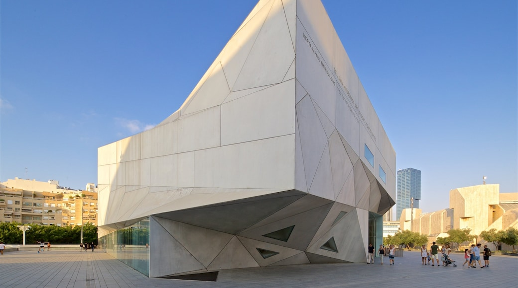 Tel Aviv Museum of Art showing a city and modern architecture as well as a small group of people