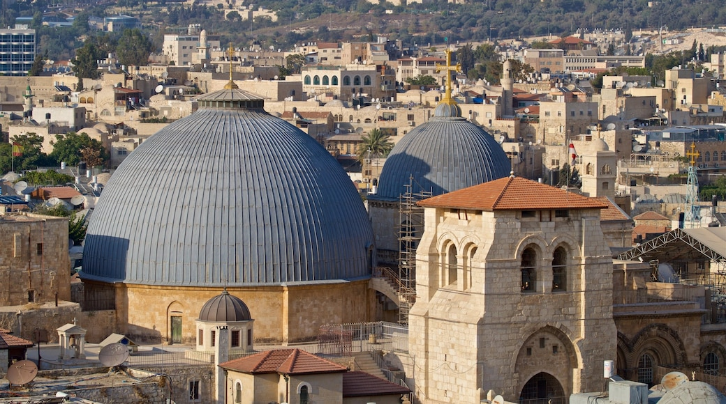 Church of the Holy Sepulchre featuring landscape views and a city