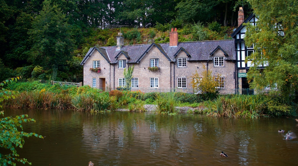 Lymm which includes a pond and a house