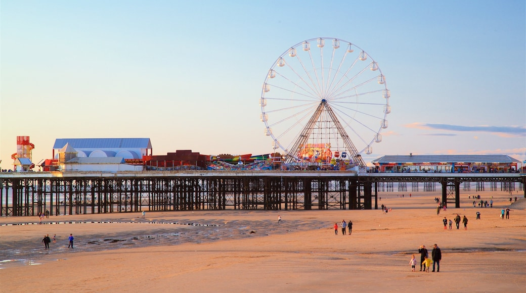 Blackpool Central Pier which includes a sunset, landscape views and general coastal views