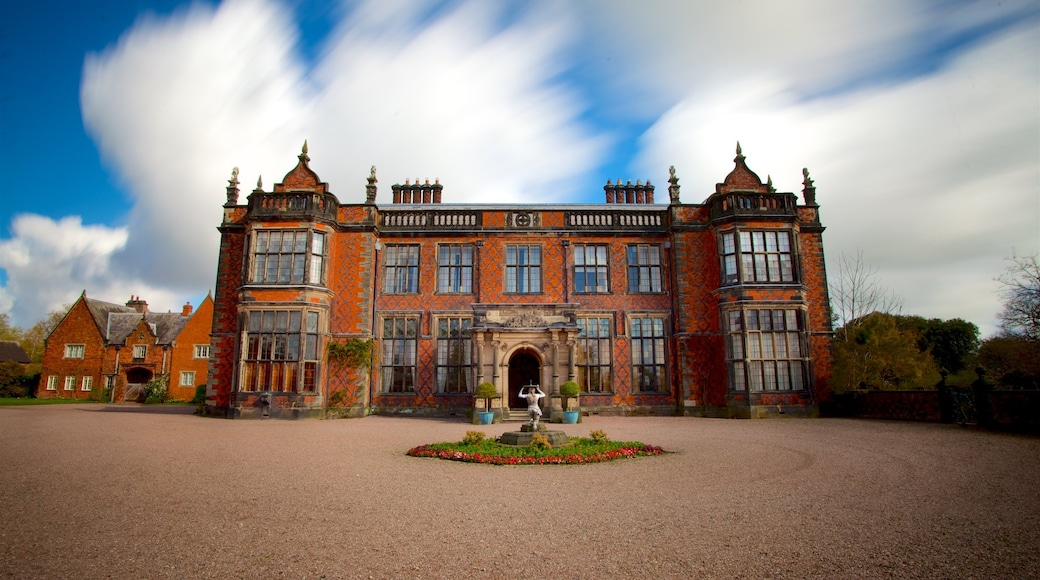 Arley Hall featuring heritage architecture, wild flowers and a house