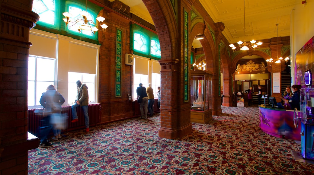 Blackpool Tower which includes heritage elements and interior views as well as a small group of people