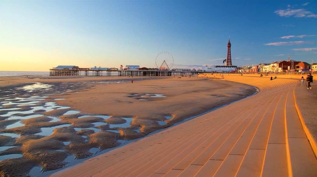 Blackpool Central Pier featuring a beach, general coastal views and a sunset