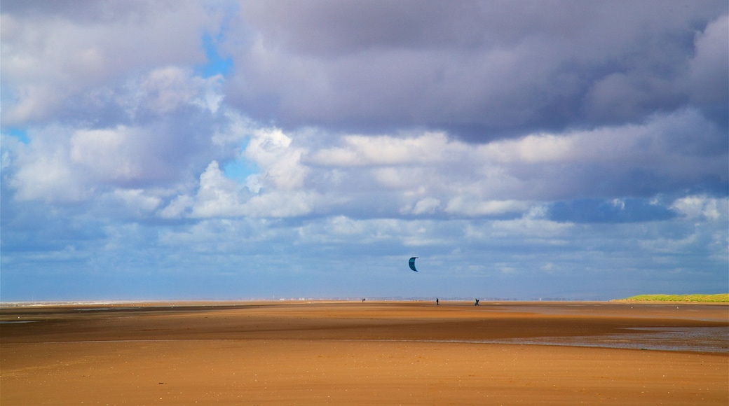 Ainsdale Beach showing kite surfing, landscape views and a sandy beach