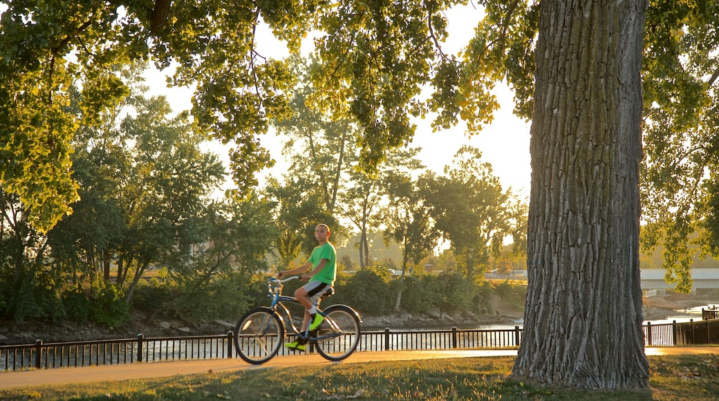 Mishawaka featuring a sunset, a garden and cycling