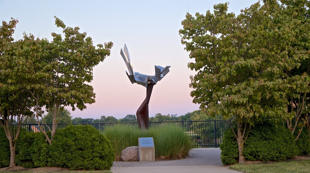 Mishawaka which includes outdoor art, a sunset and a park