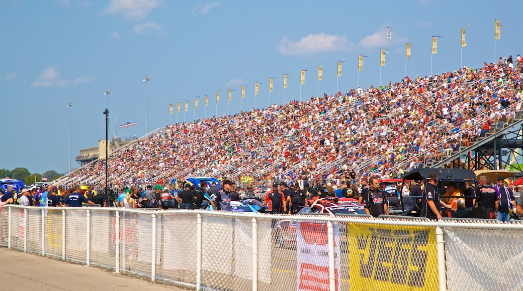 Lucas Oil Raceway as well as a large group of people